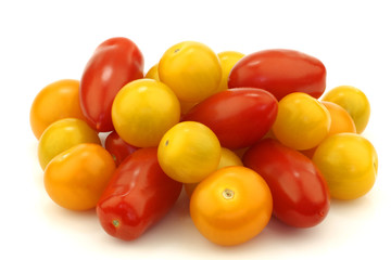 bunch of mixed red and yellow cherry and italian tomatoes