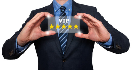 Businessman holds vip five stars in his hands. White