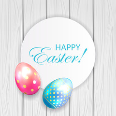 Easter card and eggs on wooden background