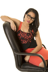 Asian woman with glasses in dress sitting arm up look