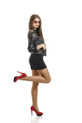 Sexy woman in black leather jacket, shorts and red high heels