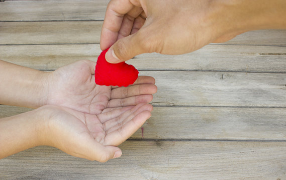 Help give love each other,Heart in Hand