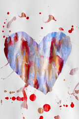 Painted heart over white paper background