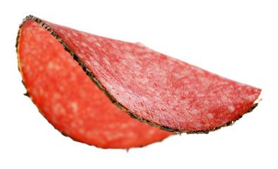 Fototapete - Slice of salami isolated on white background