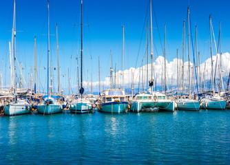 Catamaran yachts and boats in the harbor.