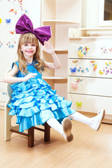 beautiful little girl in costume dolls. Interior shot