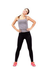 Fit young woman stretching neck