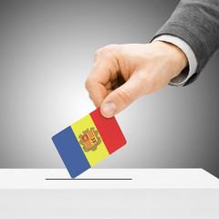 Voting concept - Male inserting flag into ballot box - Andorra