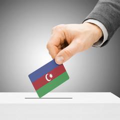 Voting concept - Male inserting flag into ballot box - Azerbaija