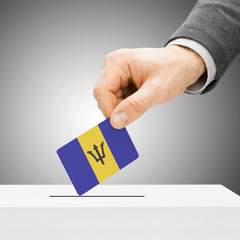 Voting concept - Male inserting flag into ballot box - Barbados