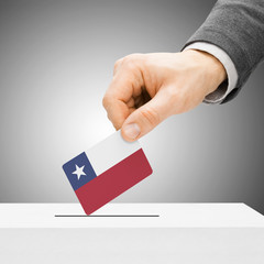 Voting concept - Male inserting flag into ballot box - Chile