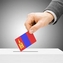 Voting concept - Male inserting flag into ballot box - Mongolia