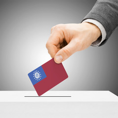 Voting concept - Male inserting flag into ballot box - Burma - M