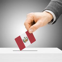 Voting concept - Male inserting flag into ballot box - Peru