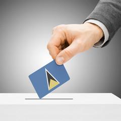 Voting concept - Male inserting flag into ballot box - Saint Luc