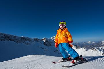 Boy in mask skiing on Krasnaya polyana ski resort