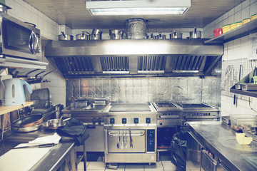 Typical kitchen of a restaurant, toned