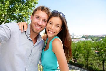 Couple tourists taking travel selfie self portrait
