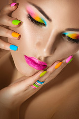 Foto op Canvas Beauty Sexy girl portrait with vivid makeup and colorful nailpolish