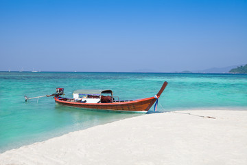 Long-tailed boat and beach