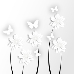 White paper butterflies on paper flowers