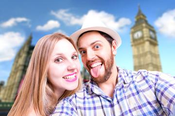 Beautiful Couple taking a selfie photo in London, England