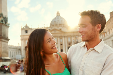 Wall Mural - Romantic couple lovers at sunset in Vatican, Italy