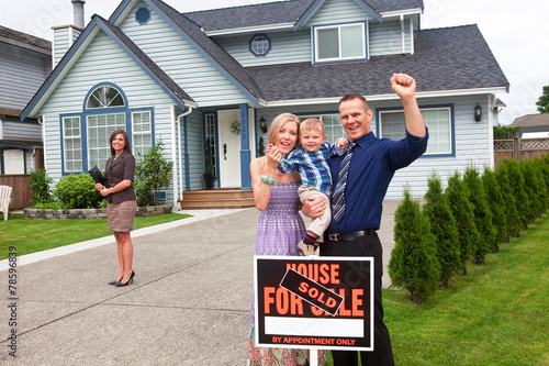 Young family celebrate buying a new home stock photo and for What is family home