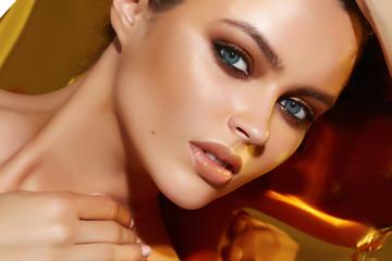 Beautiful sexy woman golden tan evening makeup natural cosmetic
