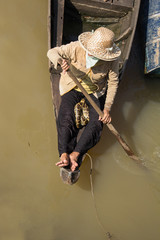 Women with snake on boat - Travel Asia