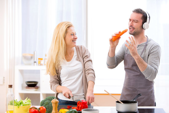 Young attractive couple having fun in the kitchen