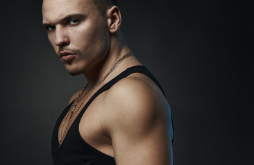 strong confident man in a black t-shirt