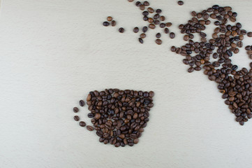A cup of coffee on a gray background