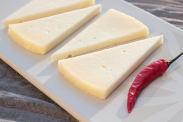Four slices of semi matured manchego cheese.