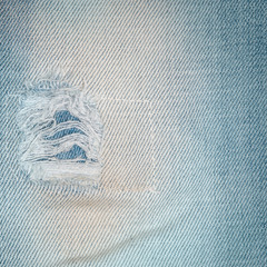 Jeans texutre with a hole