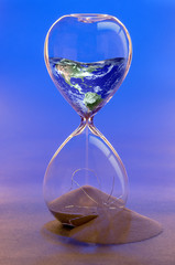 Earth in Hourglass Conceptual image. Earth by NASA