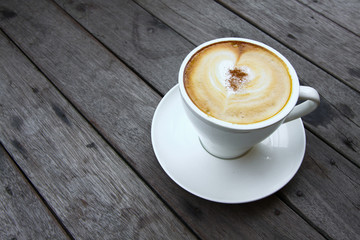 Coffee cup or fresh coffee on wooden table in morning time.
