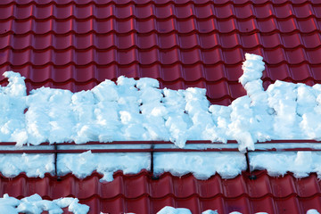 Snow Holder and Red Roof Tiles at House