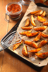 Fried Potato Slices on Tray with Slotted Ladle