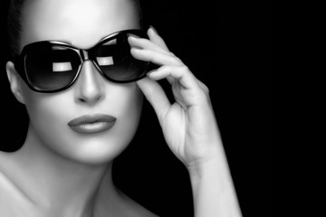 Fashion Model Woman in Black Oversized Sunglasses. Monochrome Po