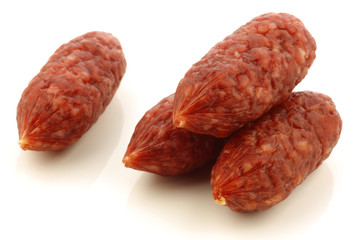 small cervelat sausages on a white background