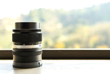 Manual focus camera lens with blurred mountain background