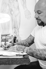 young tattoo artist drawing.
