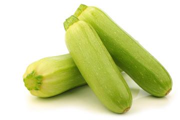 light green zucchini (Cucurbita pepo) on a white background