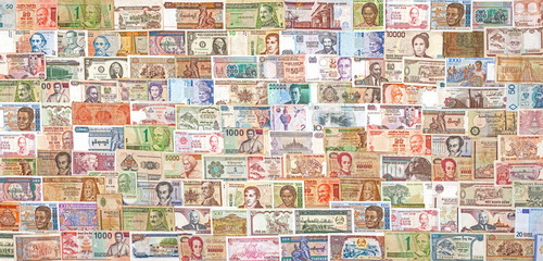 Banknotes from all over the world overlapping each other.