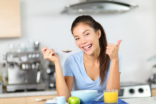 Woman eating breakfast cereals drinking juice