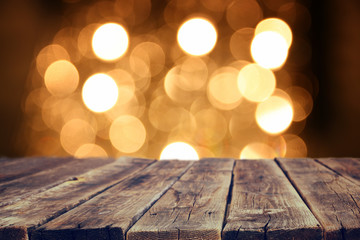 rustic wood table in front of glitter gold bright bokeh lights