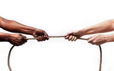 black ethnicity hands pulling rope against Caucasian stop racism