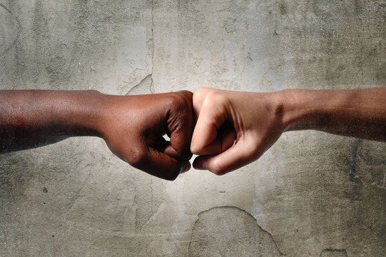 black African American ethnic fist vs white Caucasian