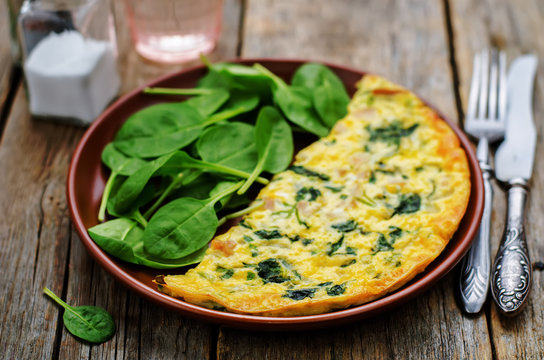 Frittata with chicken and spinach and fresh spinach